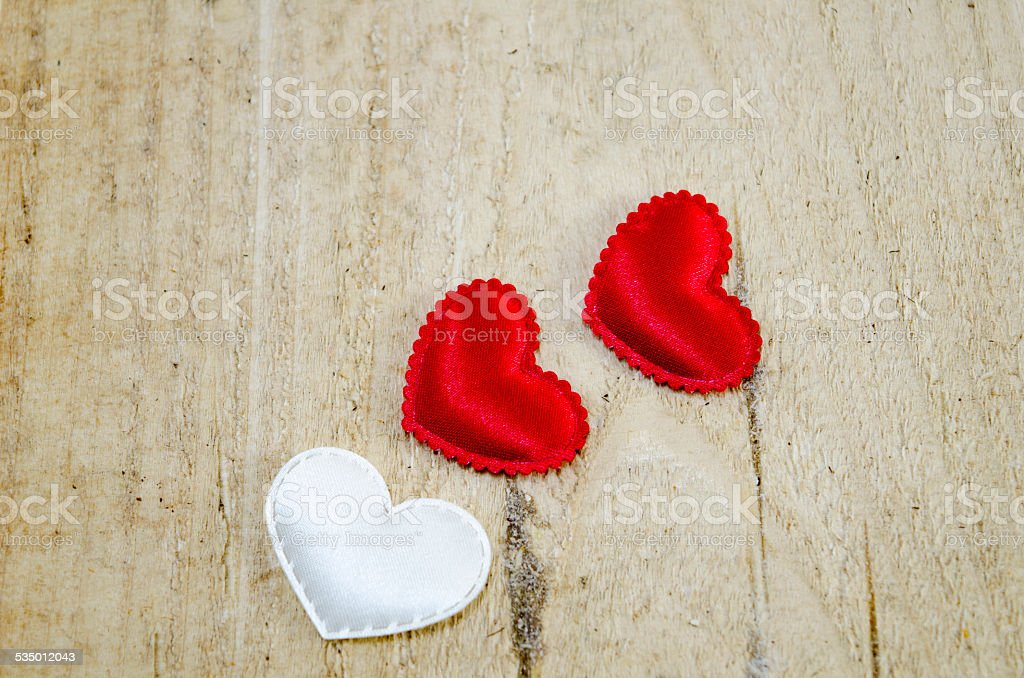 Three hearts on a wooden board royalty-free stock photo