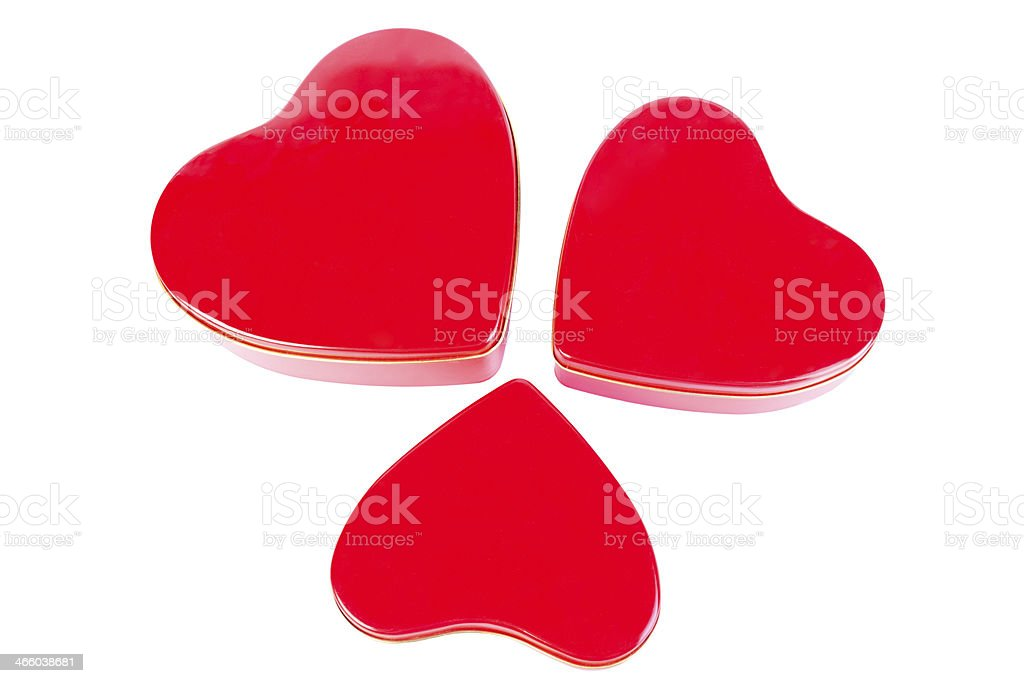Three heart-shaped red tins against a white background royalty-free stock photo