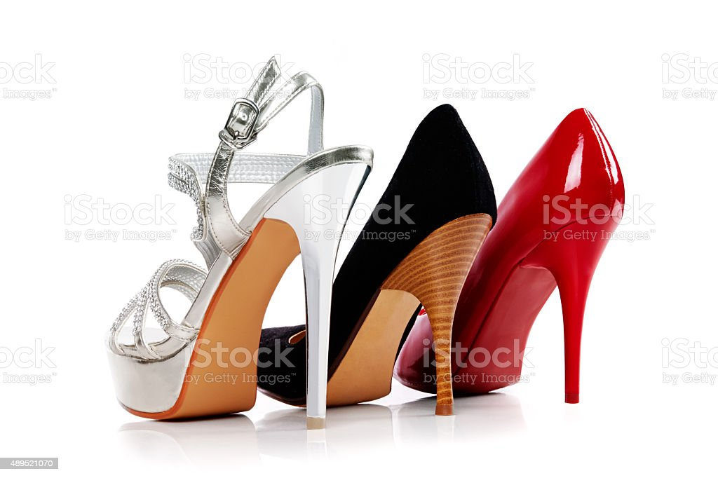 Three heels isolated on white. With Clipping path. stock photo