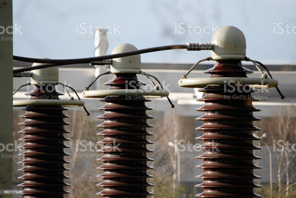 three high voltage insulators in a power station stock photo