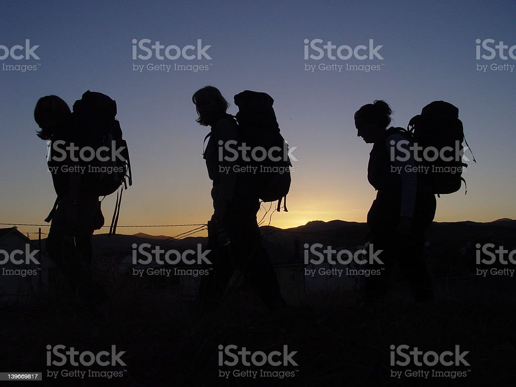 Three hikers in Camino De Santiago stock photo