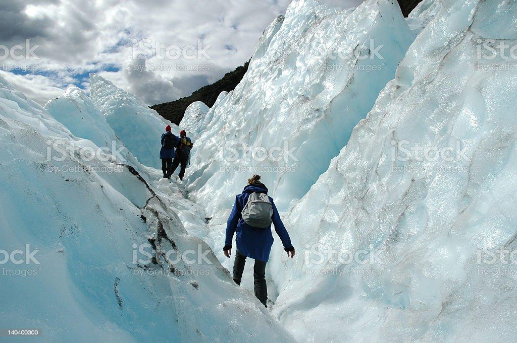 Three hikers in Franz Josef Glacier, New Zealand stock photo