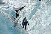 Three hikers in Franz Josef Glacier, New Zealand