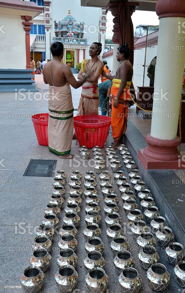 Three Hindu priests talk before ceremony: Sri Mariamman temple Singapore royalty-free stock photo