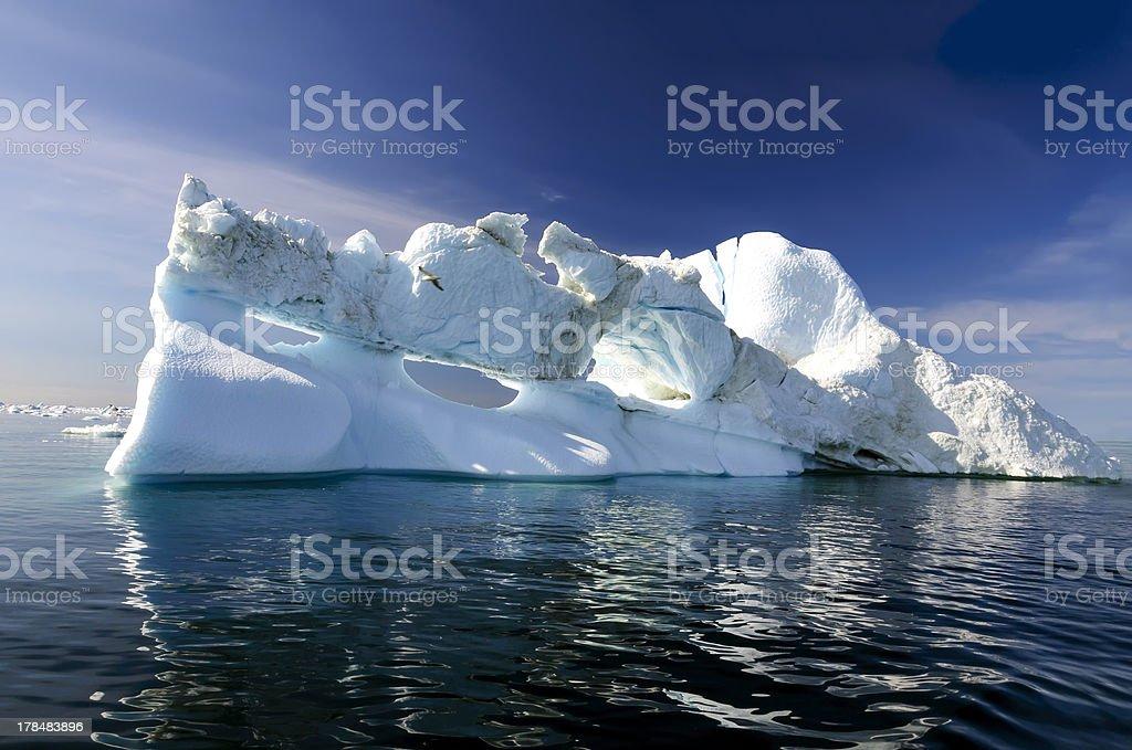 Three holes iceberg floating in Disko Bay stock photo