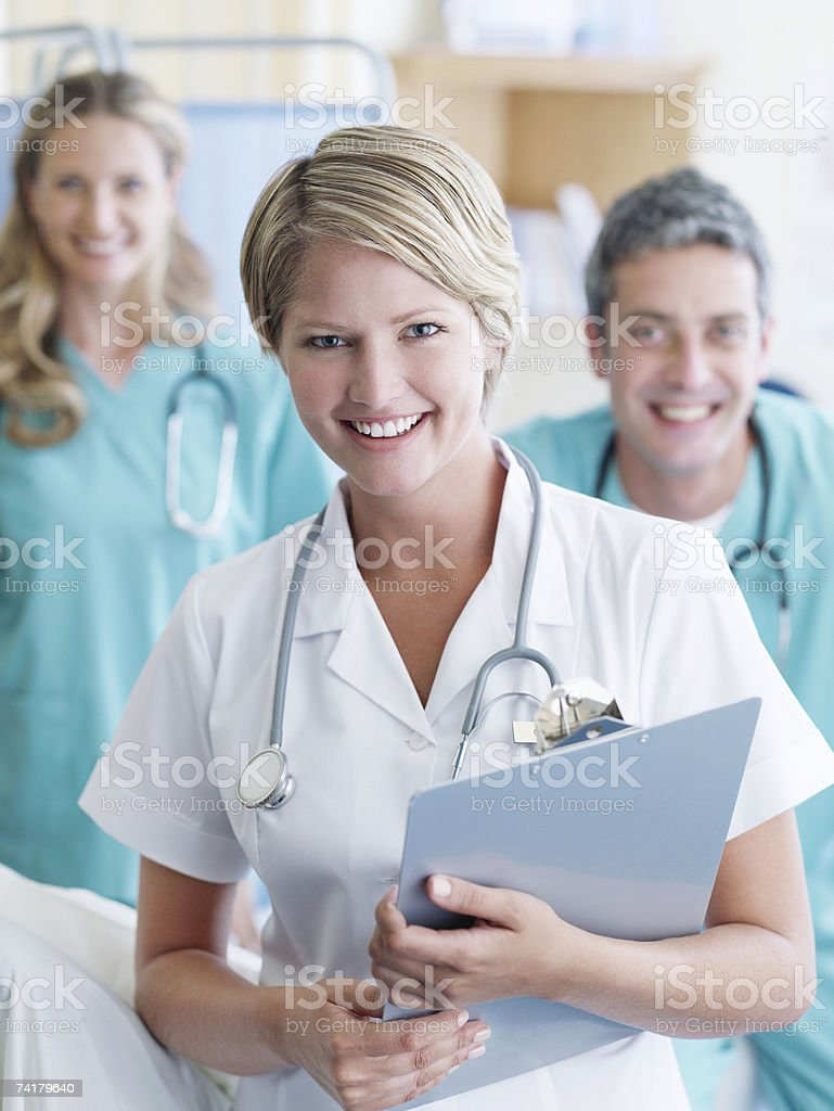 Three hospital workers smiling royalty-free stock photo