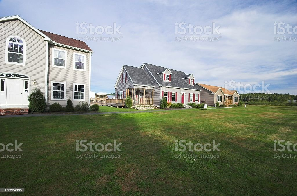 Three houses for sale on flat grassy lots stock photo
