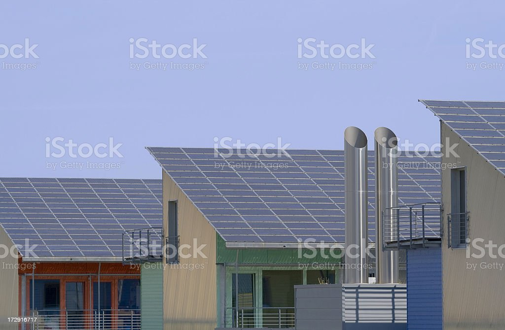 three houses with solar panels and chimney royalty-free stock photo