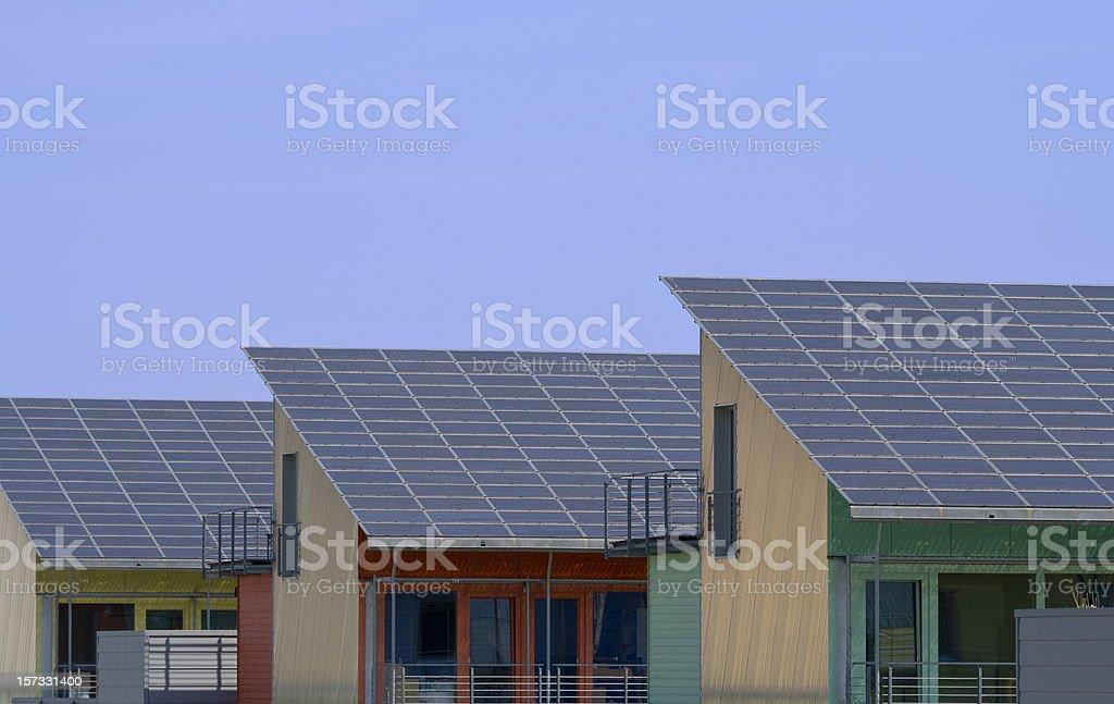 three houses with solar panels stock photo