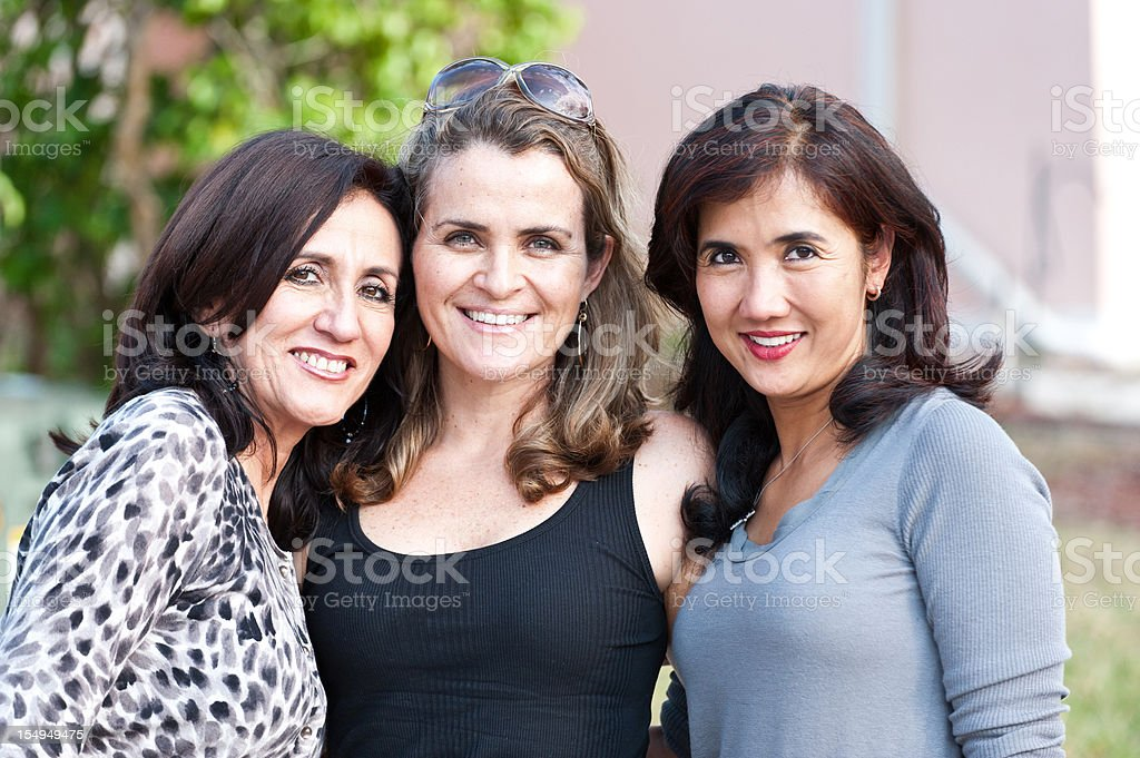 Three housewives posing outdoors royalty-free stock photo