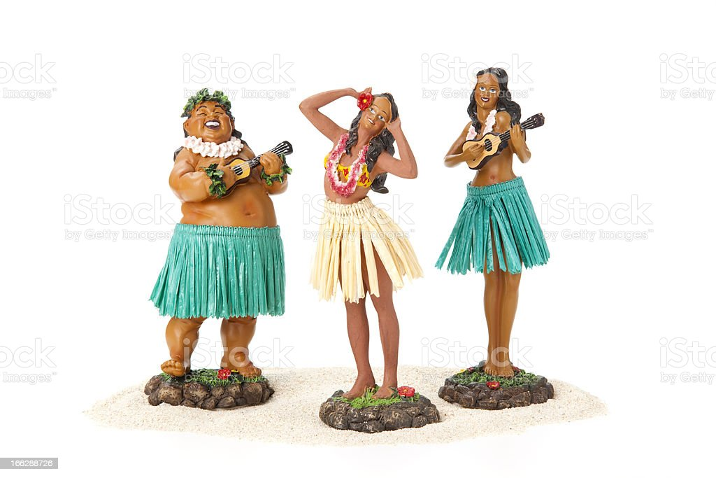 Three hula dancer figurines on white background royalty-free stock photo