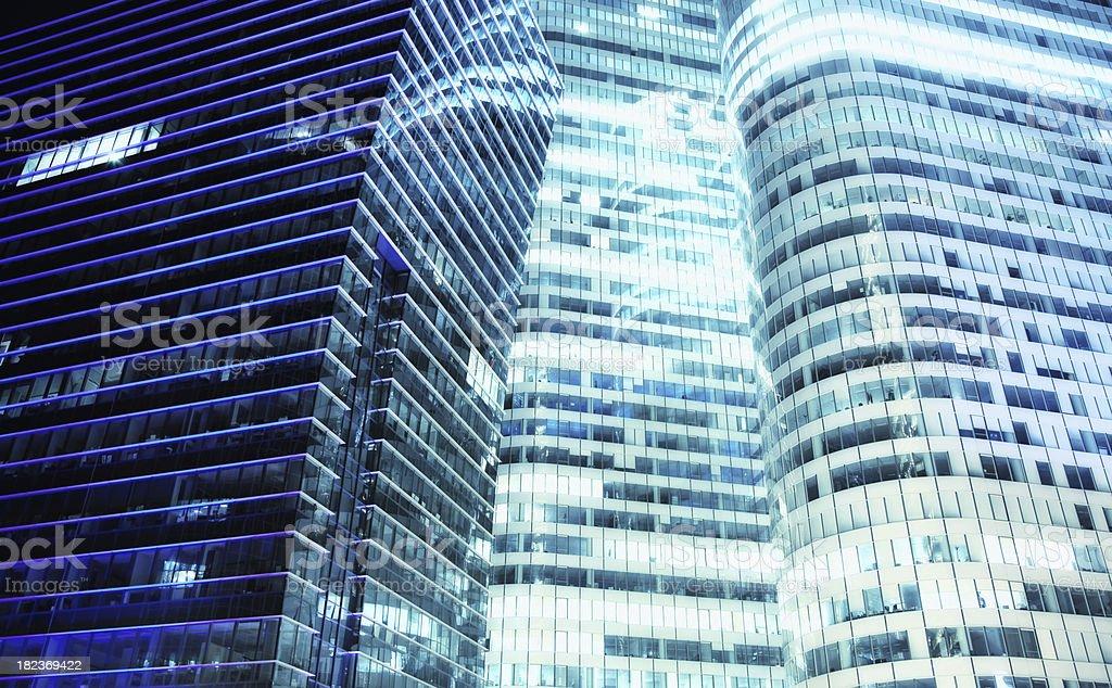 Three Illuminated Office Buildings at Night royalty-free stock photo