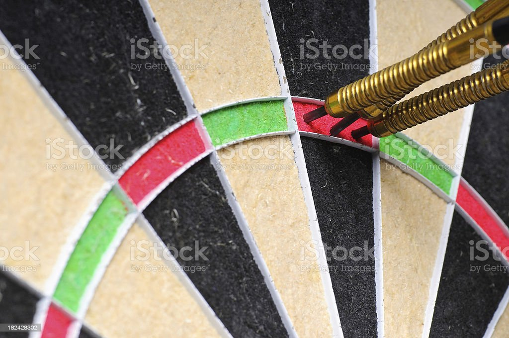 Three in a bed with golden darts royalty-free stock photo