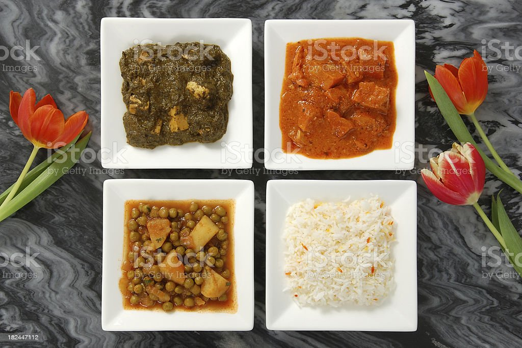 Three Indian Curries and Rice stock photo