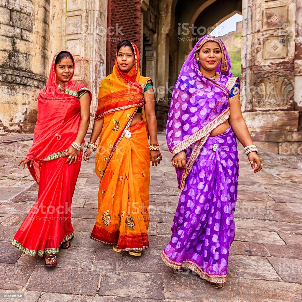 Three Indian women on the way to Mehrangarh Fort, India stock photo