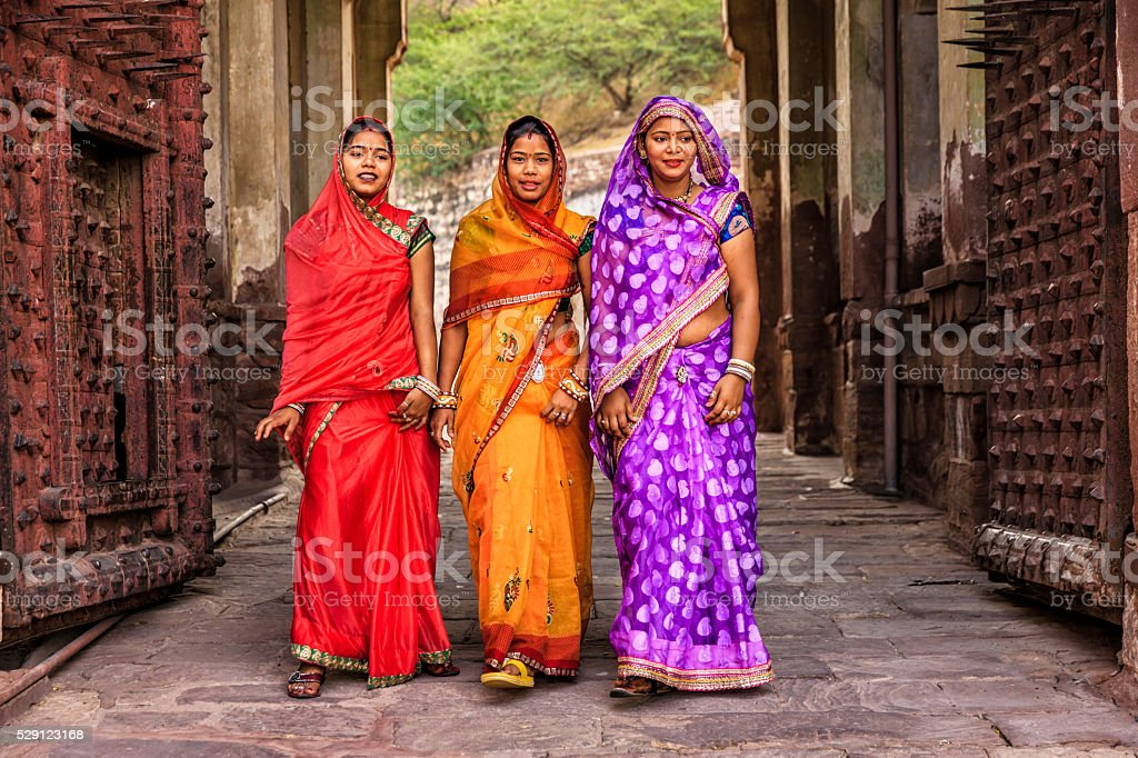 Three Indian women on the way to Mehrangarh Fort, India stock photo