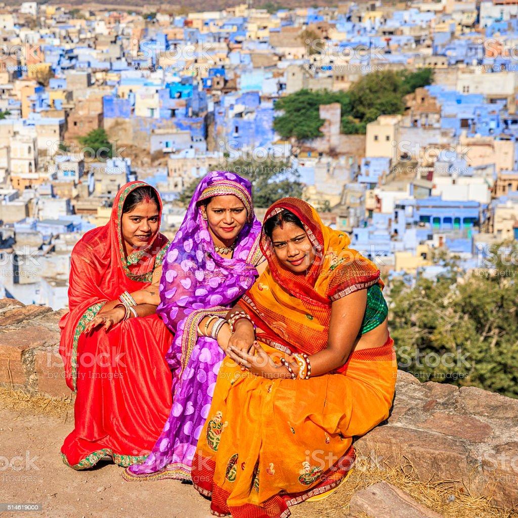 Three Indian women resting in Mehrangarh Fort, Jodhpur, India stock photo