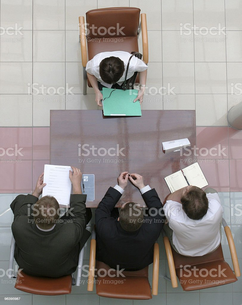 Three individuals interviewing one royalty-free stock photo