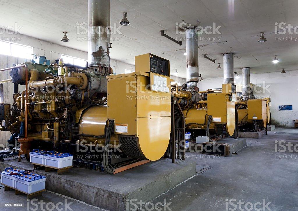 three industrial electricity generators stock photo