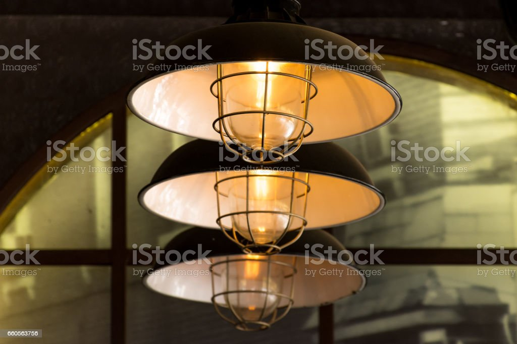 Three industrial retro style electric ceiling lights in a row. stock photo