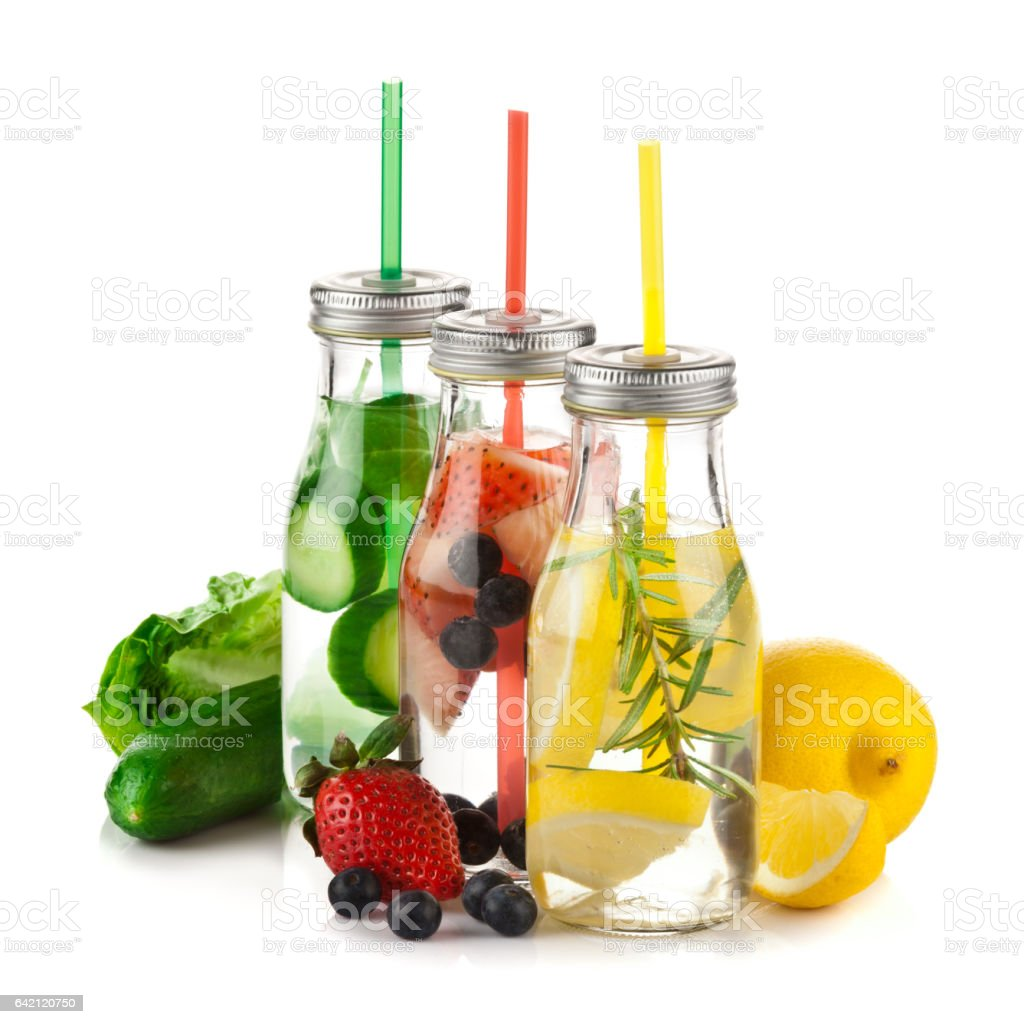 Three infused lemon water detox drinks in a row on white background stock photo