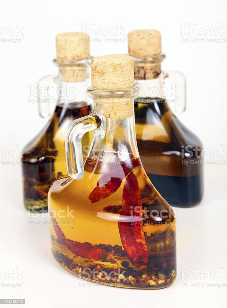 Three infused olive oils stock photo