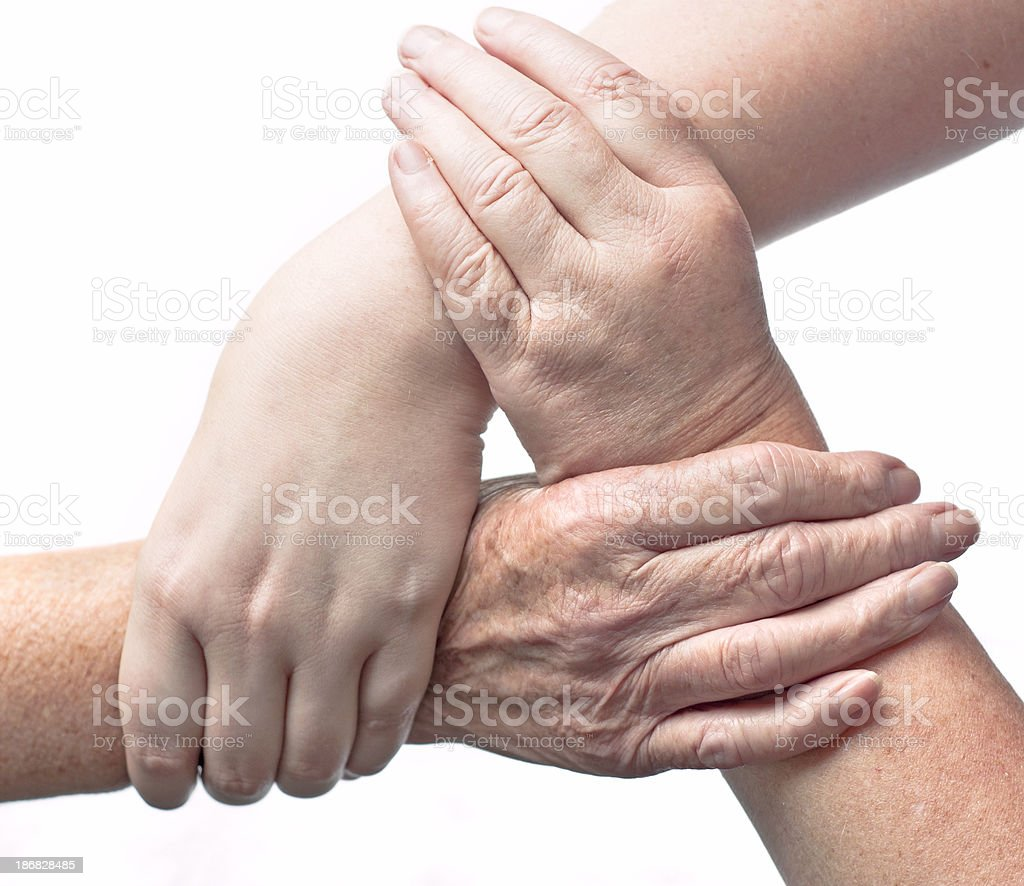 Three Interlocked Female Hands Of Different Ages royalty-free stock photo