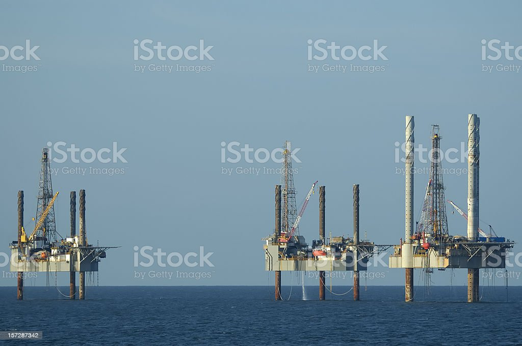 Three Jack-up oil rigs. (well platforms) royalty-free stock photo