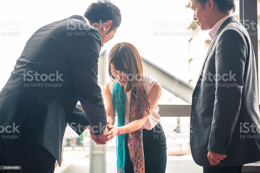 Three Japanese Businesspeople Meeting in Kyoto, Japan stock photo