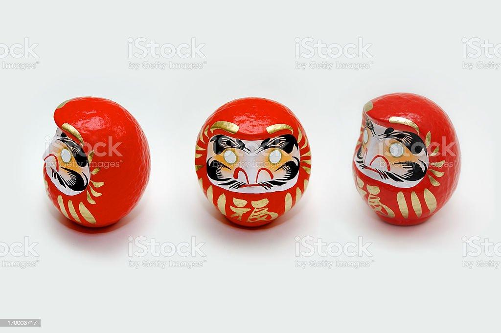Three Japanese Daruma Dolls stock photo
