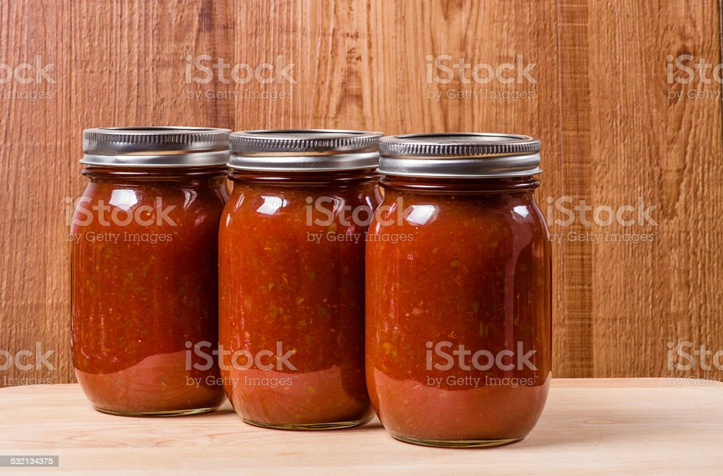 Three jars of homemade tomato sauce stock photo