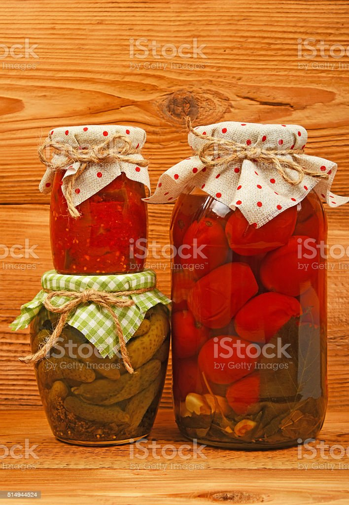 Three jars of pickles over vintage wood royalty-free stock photo