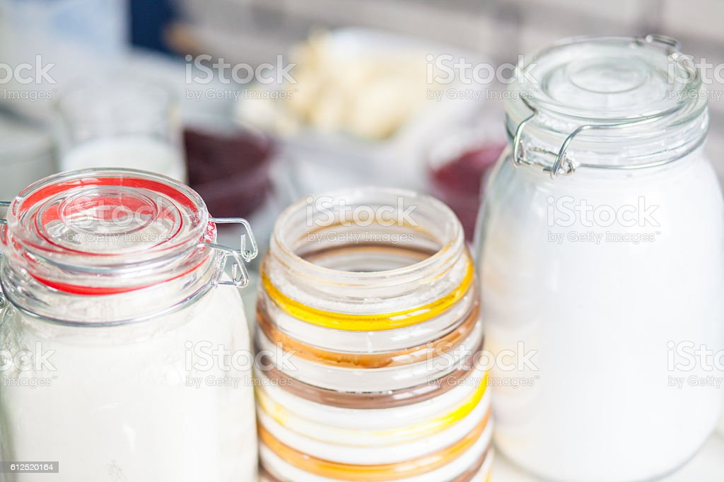 three jars with the flour in the kitchen royalty-free stock photo