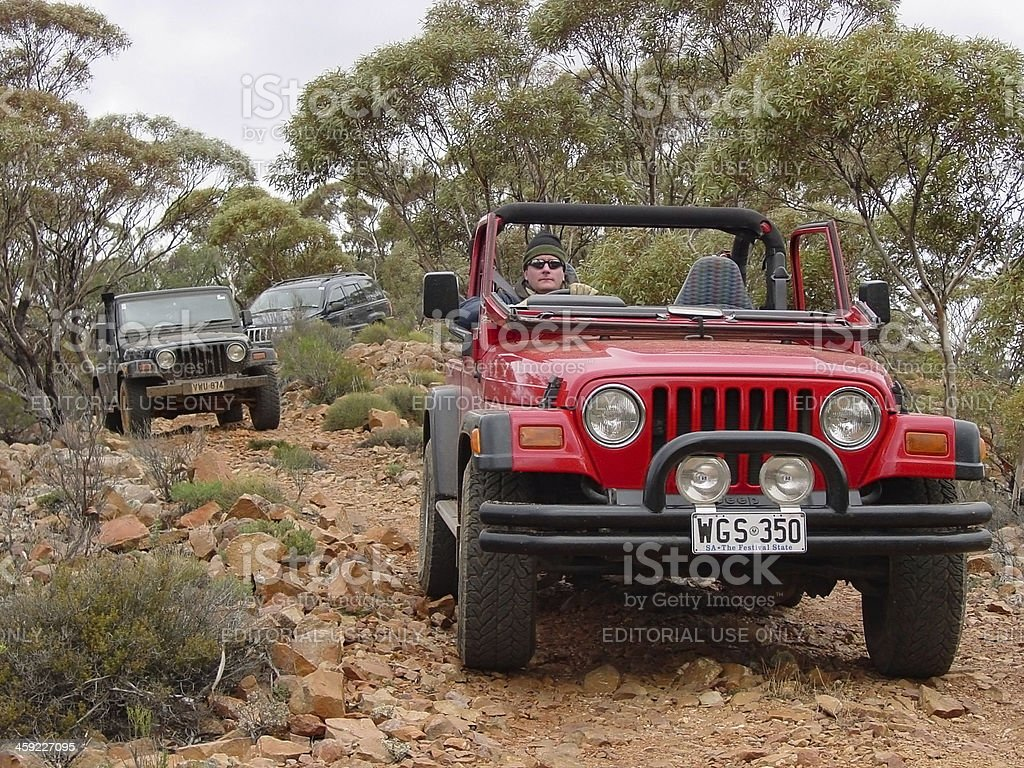 Three Jeeps driving offroad, rocky tracks in Flinders Ranges S.A. stock photo