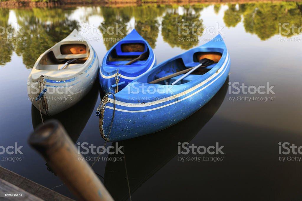 three kayak boats in lake royalty-free stock photo