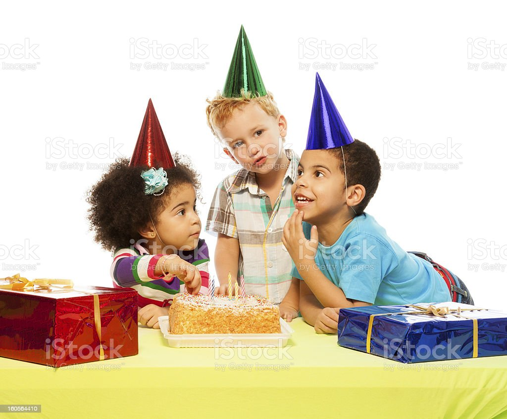 Three kids and birthday cake royalty-free stock photo