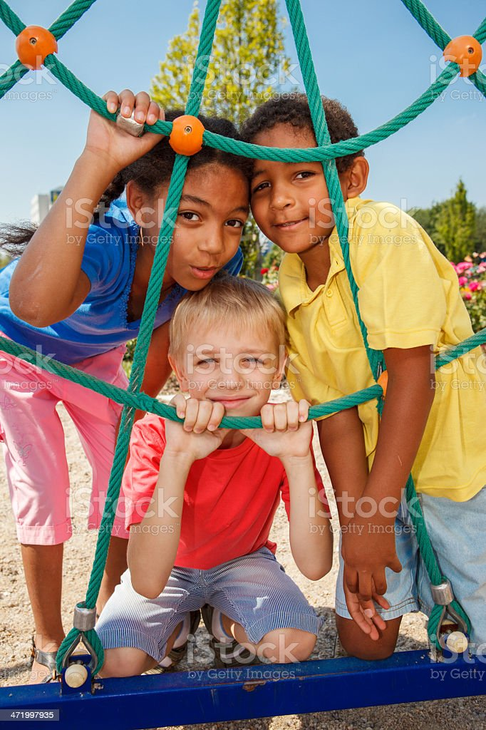 Three kids at the playground stock photo