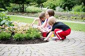 three kids gardening together