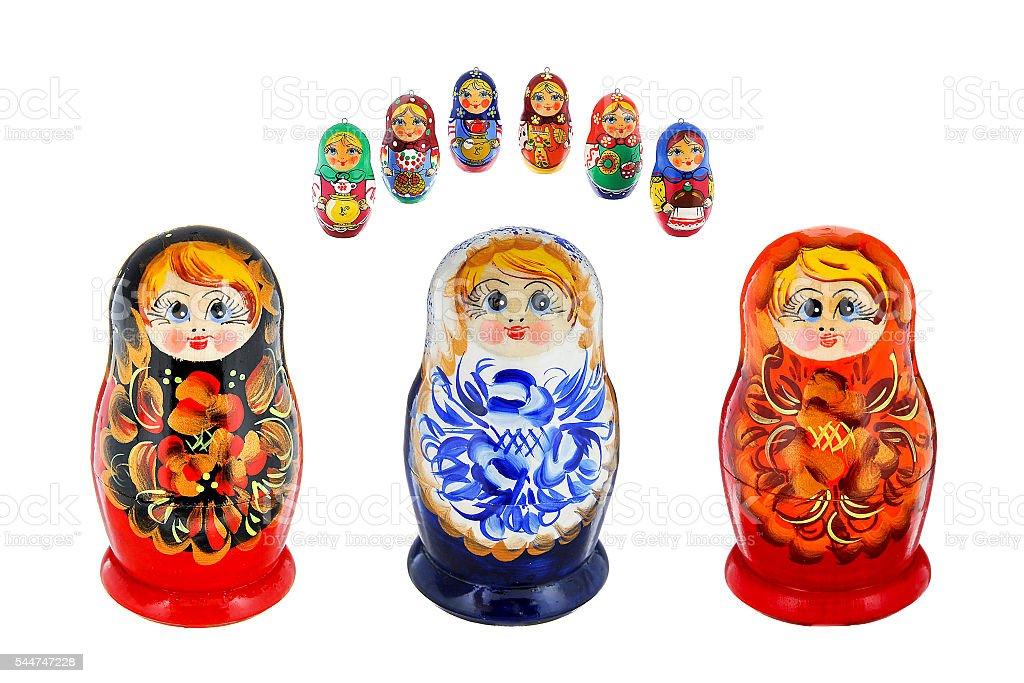 Three large and six small russiann nesting dolls stock photo