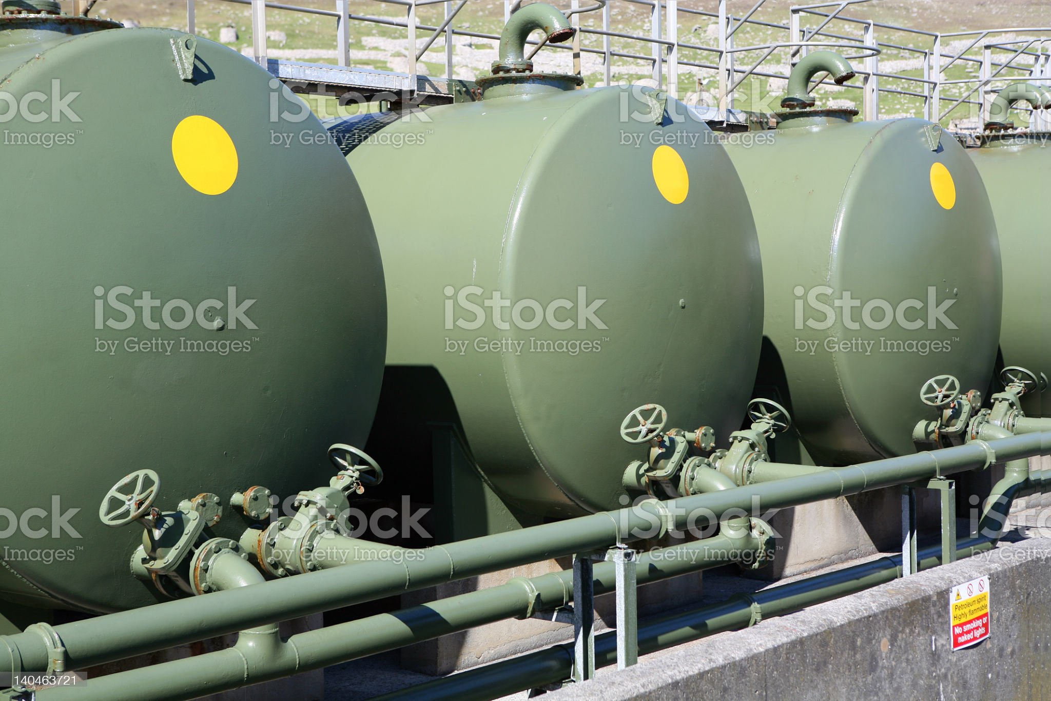 Three large green outdoor fuel tanks royalty-free stock photo