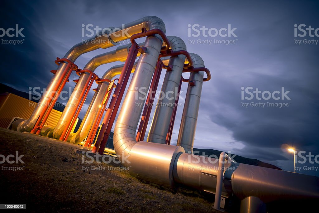 Three large pipelines against the night sky royalty-free stock photo