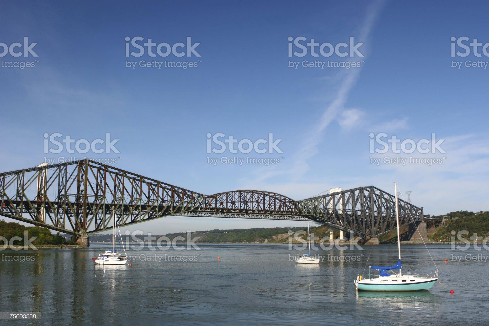 Three leisure sail boats near the Quebec City old bridge royalty-free stock photo