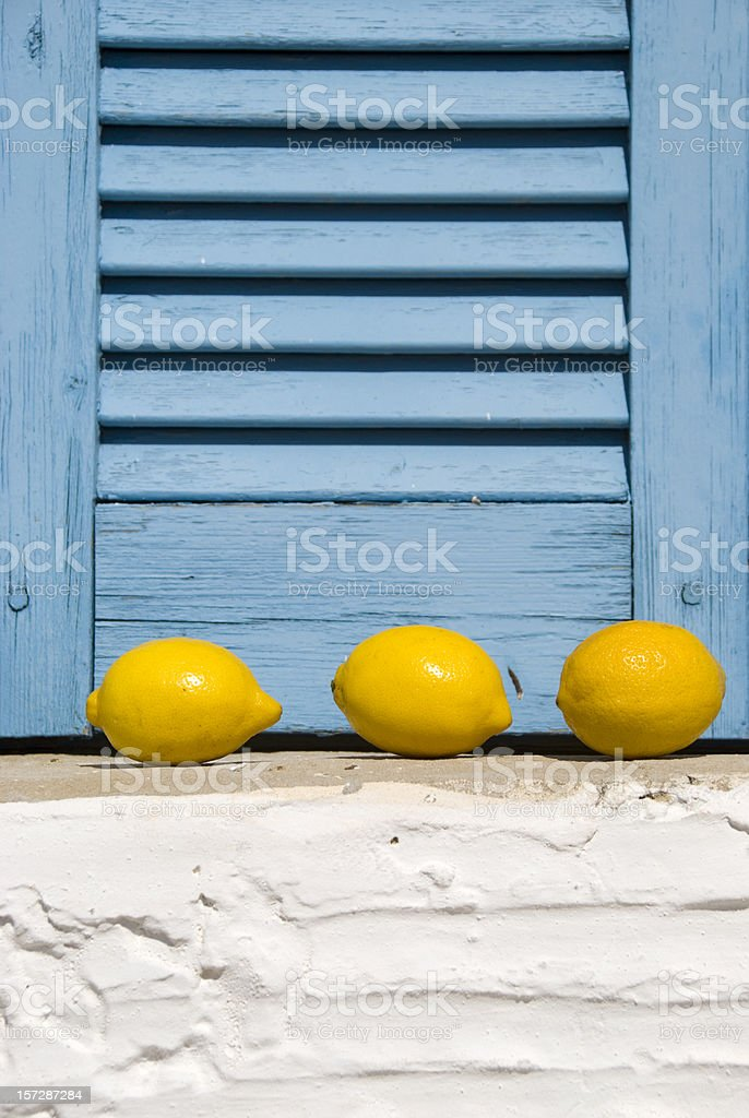 Three lemons in a window royalty-free stock photo
