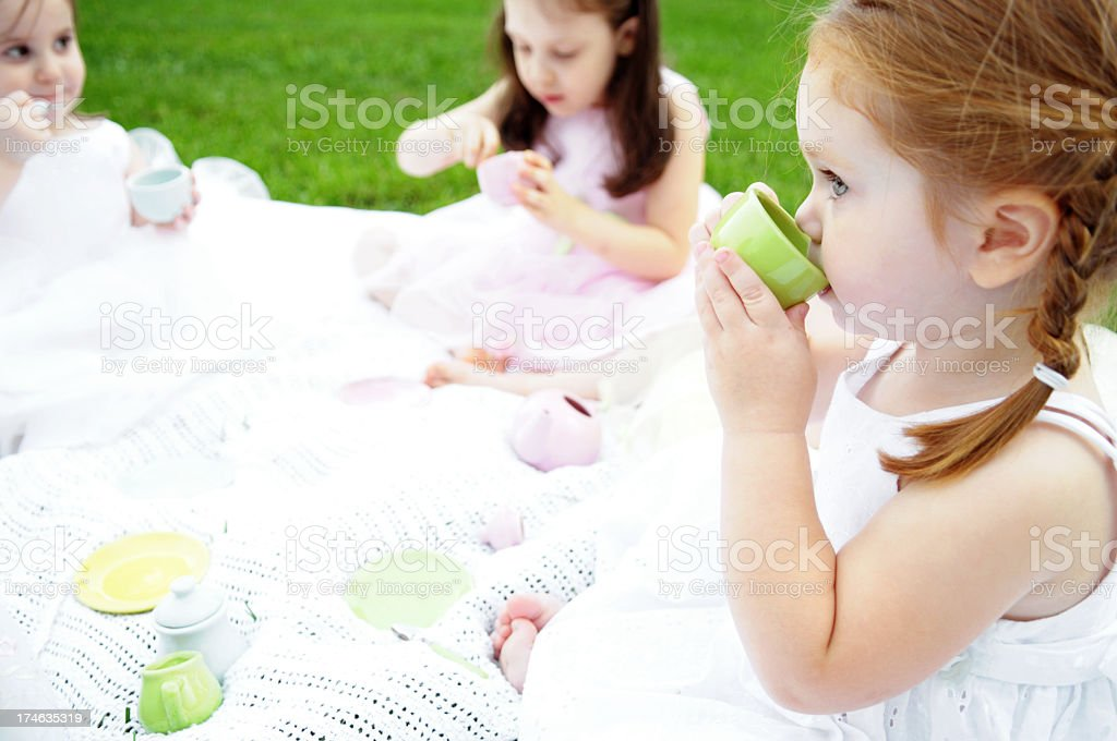 Three Little Girls in Dresses Having a Tea Party royalty-free stock photo