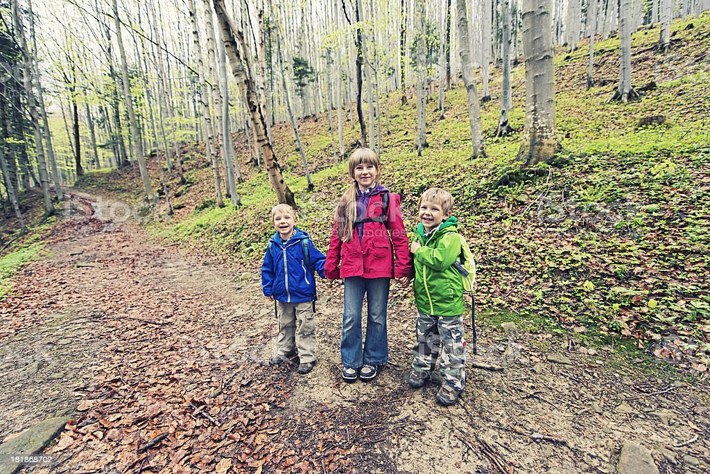 Three little hikers royalty-free stock photo