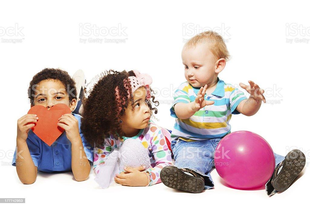 Three little kids playing royalty-free stock photo