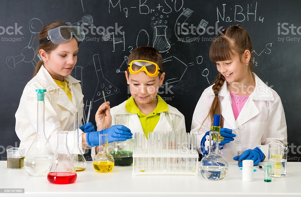 three little students on chemistry lesson in lab stock photo