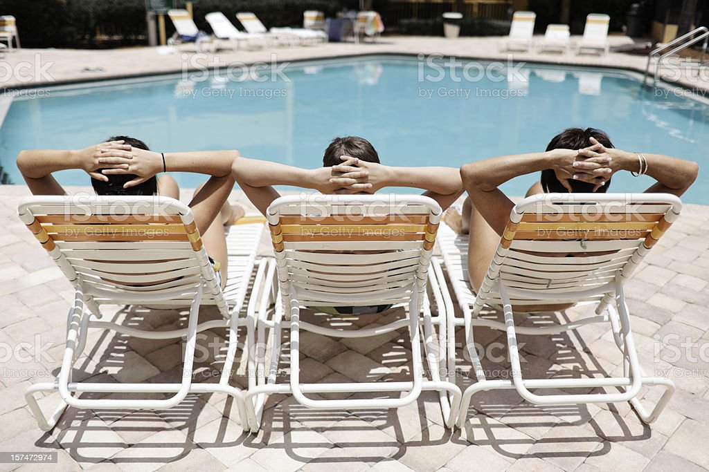 Three Loungers with people royalty-free stock photo