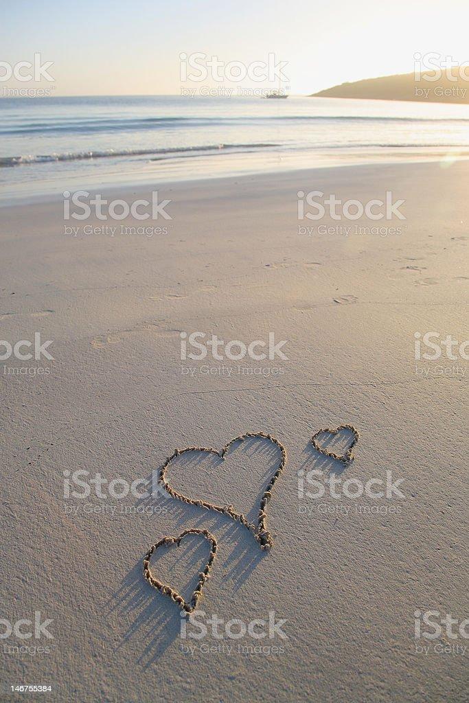 Three love hearts on a beach royalty-free stock photo