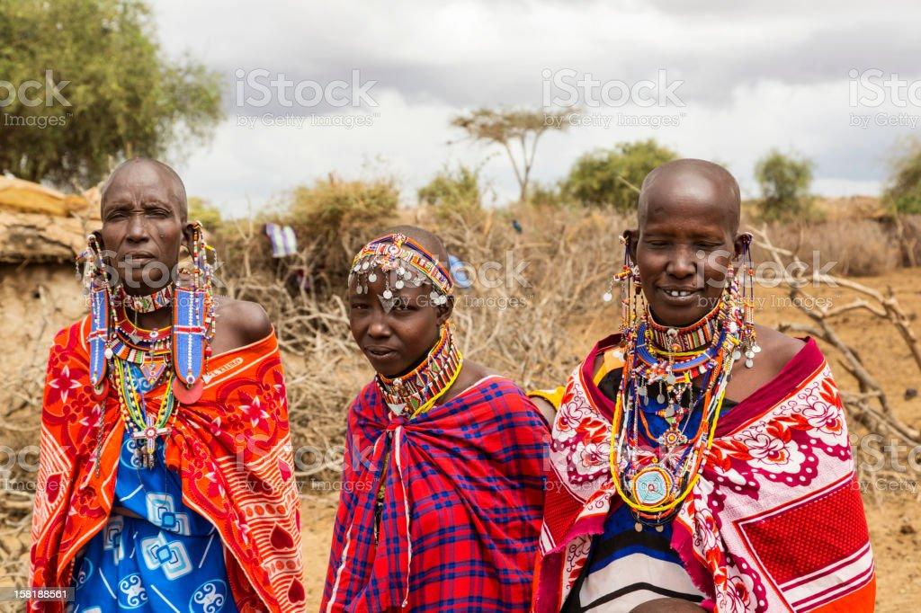 Three Maasai women outside their village. stock photo